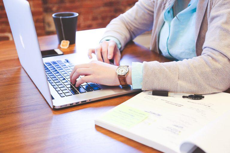 Student using laptop - Bryton Insurance